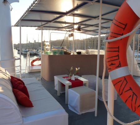 Sunset aperitive on board at sea